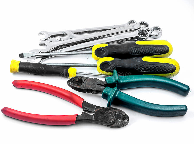 Hjälpmedeluppsättning av skiftnyckel, skiftnyckel, plattång och skruvmejsel fotografering för bildbyråer