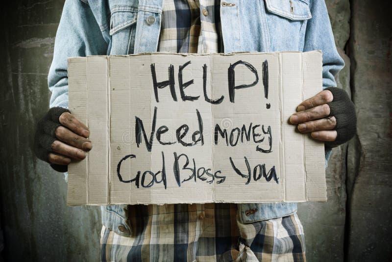 hjälppengarbehov arkivbild