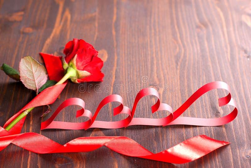 Hjärta av en ros med ett band arkivfoton