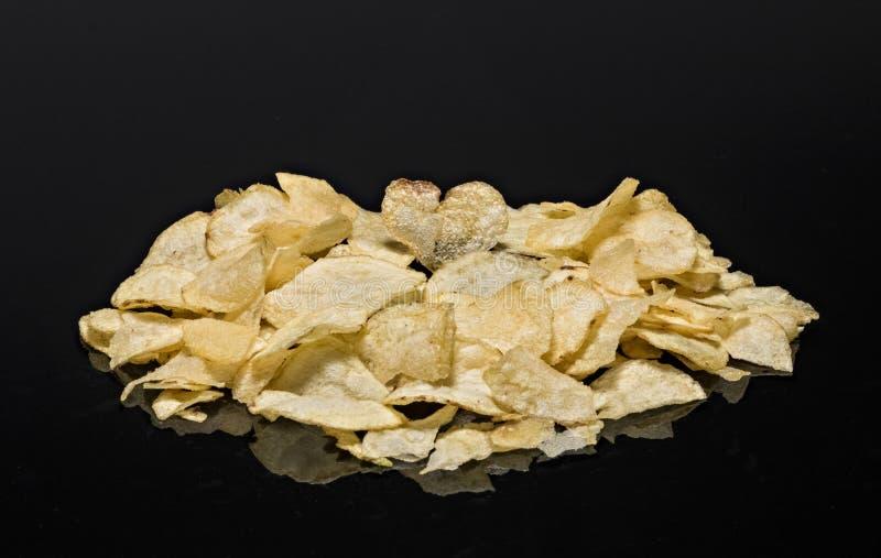 Hjärta formad chip överst av chiphögen arkivbilder