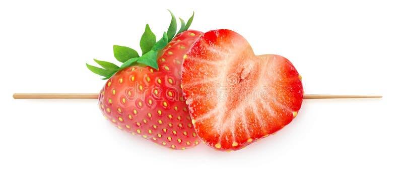 Hjärta-formade jordgubbar på en pinne royaltyfri foto