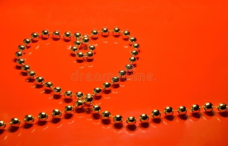 Hjärta från pryder med pärlor arkivbilder