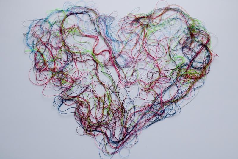 Hjärta från sömnadtråden - bakgrund arkivfoto