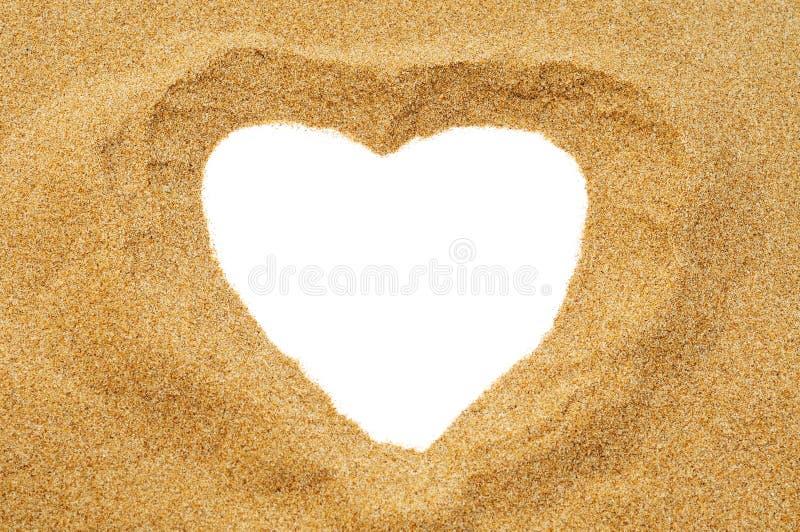 Hjärta i sanden fotografering för bildbyråer