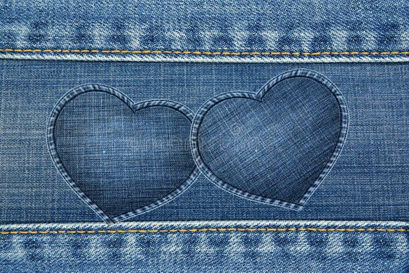 Hjärta inramar gjort av jeans texturerar fotografering för bildbyråer
