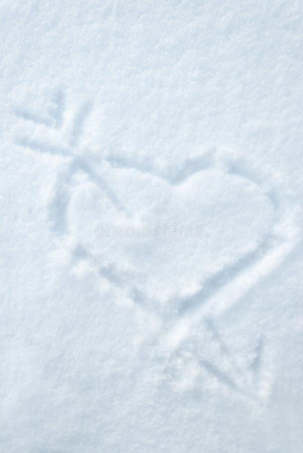Download Hjärta- Och Pilattraktion På Smow Fotografering för Bildbyråer - Bild av frost, flake: 28615251