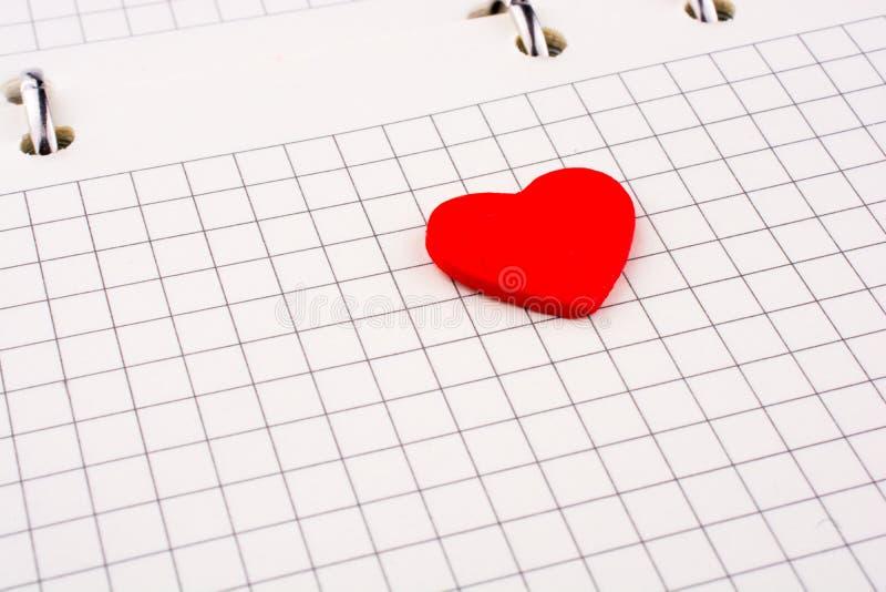 Hjärta på en anteckningsbok vektor illustrationer