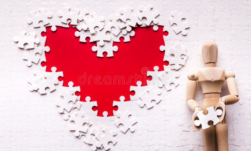 Hjärta som göras av pussel, sjukvårdbegrepp royaltyfri fotografi