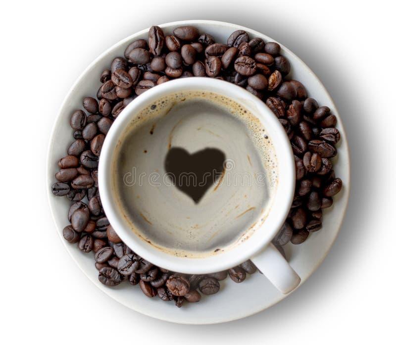 Hjärtaform eller förälskelsesymbol på kaffekoppen royaltyfri fotografi