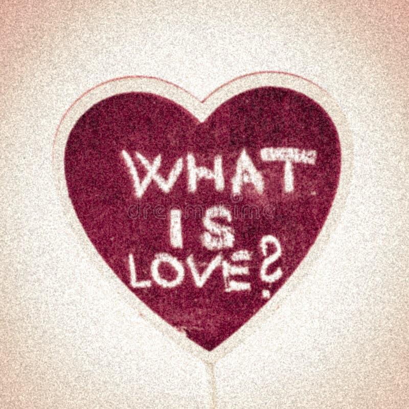 Hjärtaform med text - är vad förälskelse? royaltyfri foto