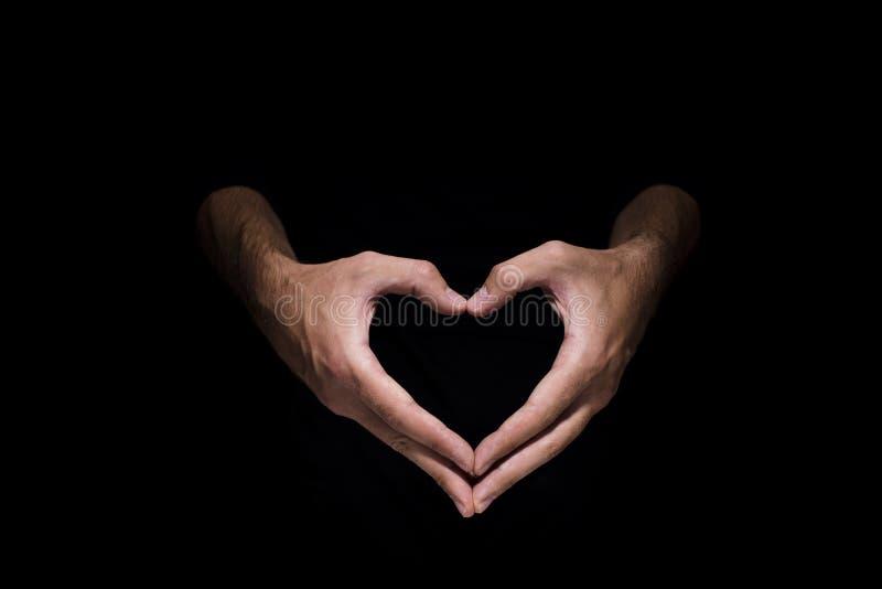 Hjärtaform som göras av två, gömma i handflatan royaltyfri bild