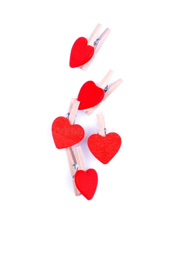 Hjärtor och blommor till valentin som isoleras på vit bakgrundsintelligens fotografering för bildbyråer