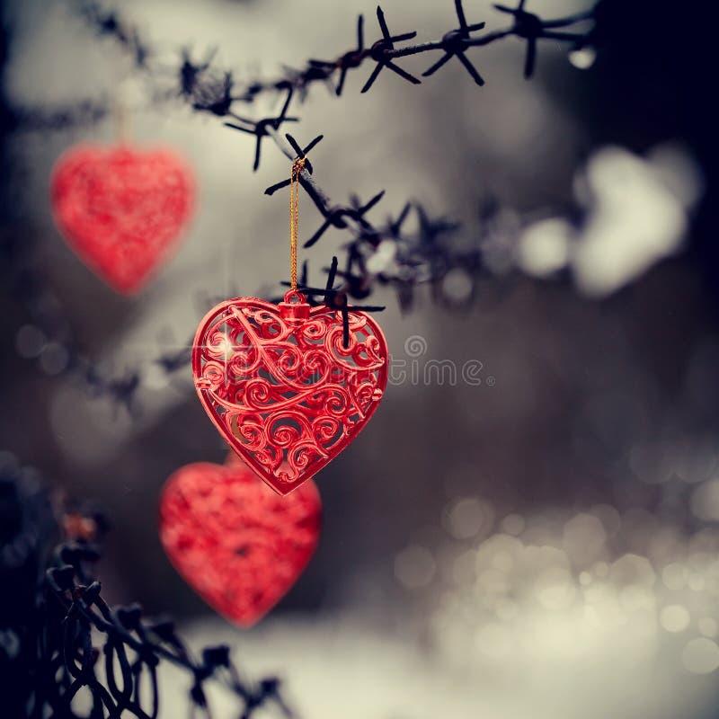 Hjärtor och försett med en hulling - tråd arkivbild