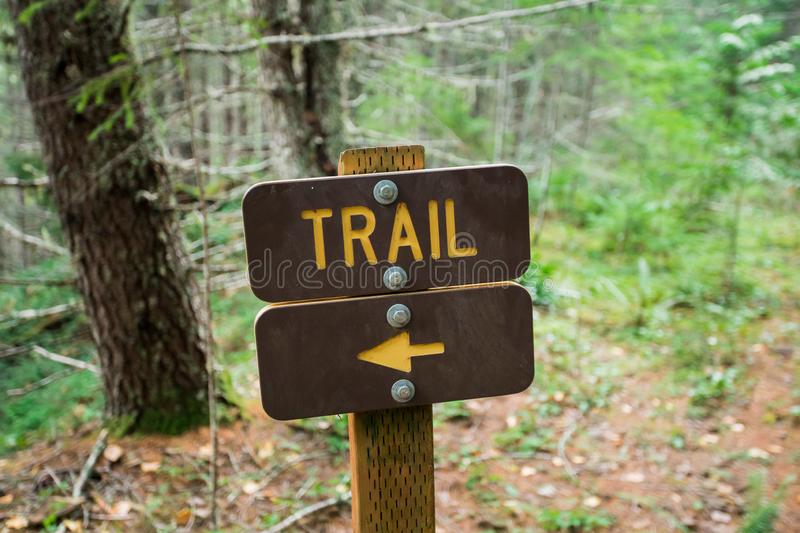 Hking Trail Sign With Direction Arrow Pointing Left stock photography