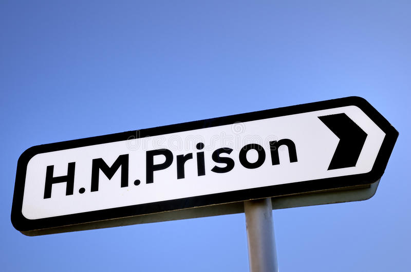 HM Prison Sign. Sign pointing the way to a prison in the UK stock photo
