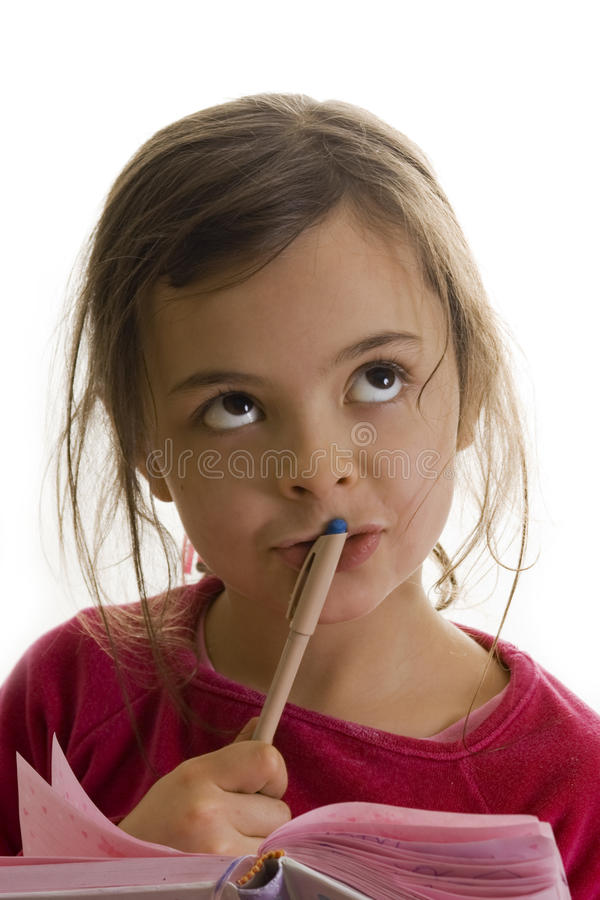 Hmmm...what I can write.. Little girl thinking what she can write in her diary royalty free stock photography