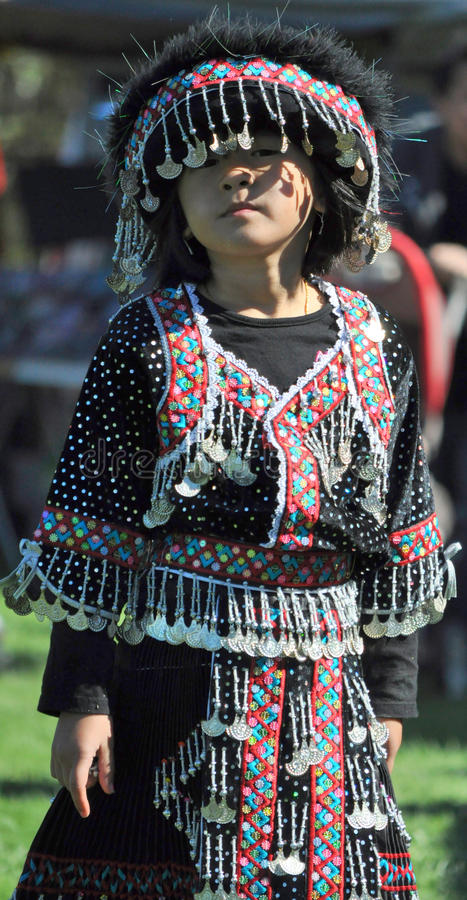 Hmong girl in costume. Hmong annual harvest festival where girls dress up on bright colored costumes royalty free stock photos