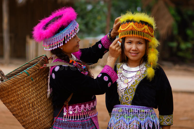 Hill tribe woman in colorful costume dress. Hmong hill tribe women in colorful costume dress smile happiness royalty free stock photography