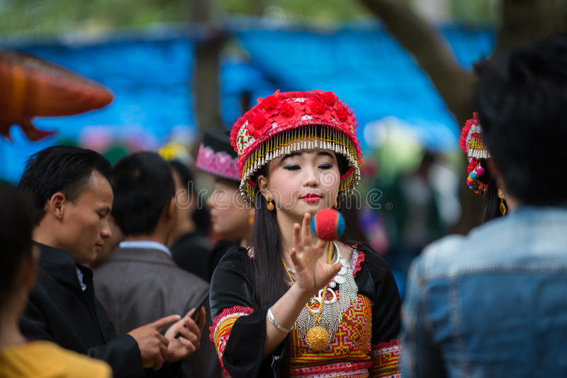 Hmong New Year Celebration. Hmong girls involved in a traditional ceremony in Luang Prabang stock image