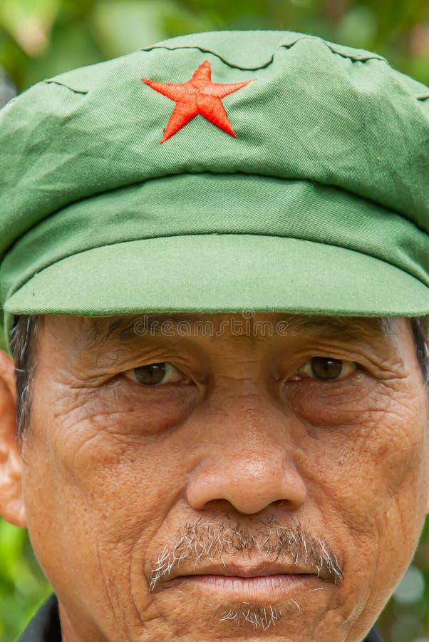 Hmong tribe senior man wearing a Mao style cap stock photo