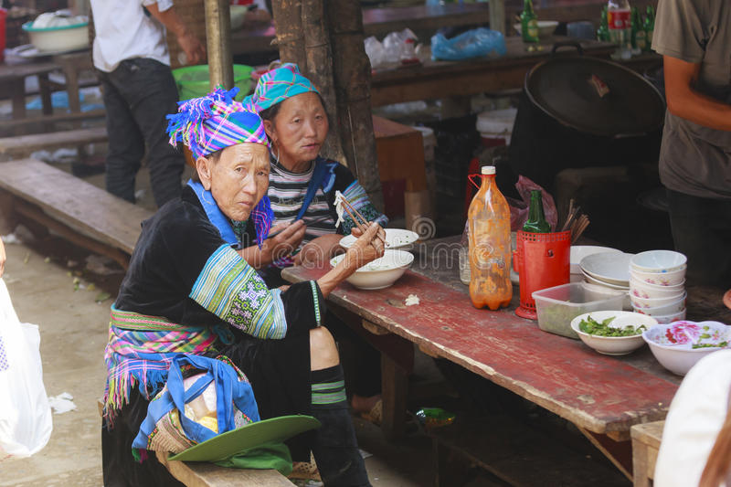 Hmong woman people are colorful costume trading of agricultural products at the LAOCAI. Sunday market in Sapa Vietnam royalty free stock photography