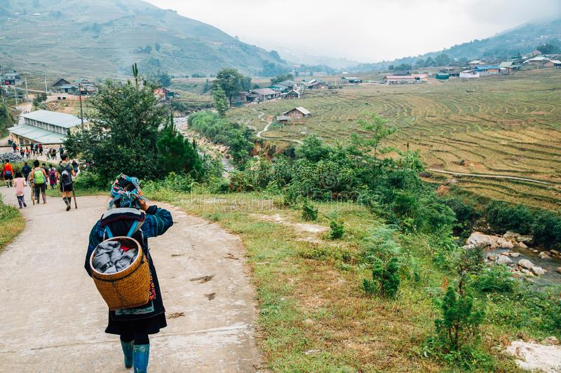 Hmong women and Lao Chai countryside village in Sapa, Vietnam. Hmong women and Lao Chai village in Sapa, Vietnam royalty free stock images