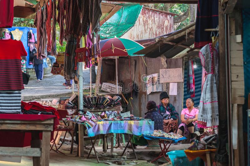 Hmong women selling clothes. Doi Pui hill tribe village, handicraft market of the ethnic minority of miao or maew people. Doi Pui hill tribe village, handicraft royalty free stock photo