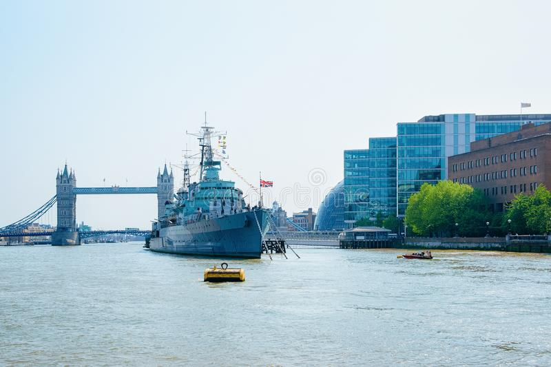 HMS Belfast Ship and Tower Bridge in London stock photography