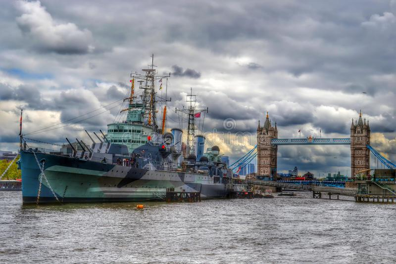 HMS Belfast and Tower Bridge, London. royalty free stock images