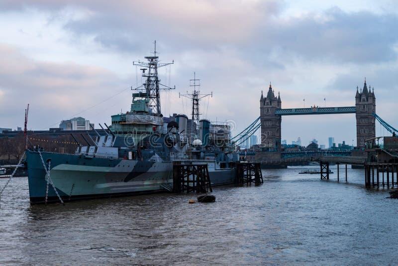 HMS Belfast with Tower Bridge stock photography