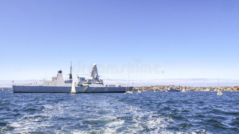 HMS Daring D32 Royal Navy Destroyer moor in Sydney harbor for participating in International Fleet Review Sydney 2013. SYDNEY, AUSTRALIA - OCTOBER 4, 2013 : HMS royalty free stock image