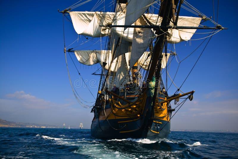 HMS Surprise sailing at sea under full sail royalty free stock images