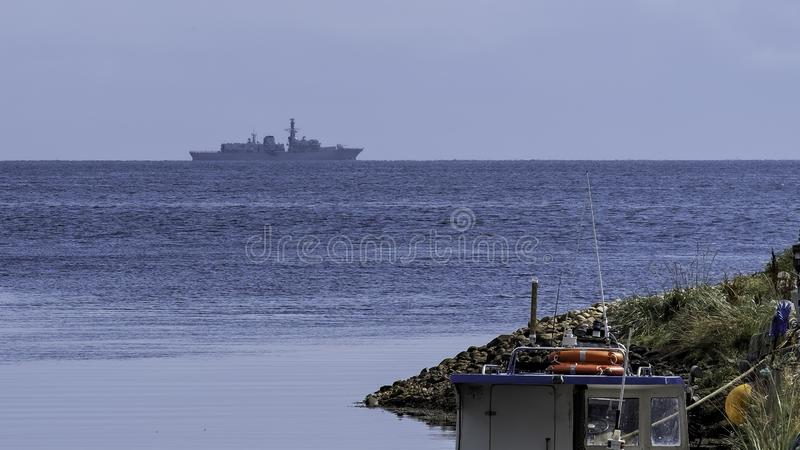 HMS Sutherland off Brora harbour stock photography