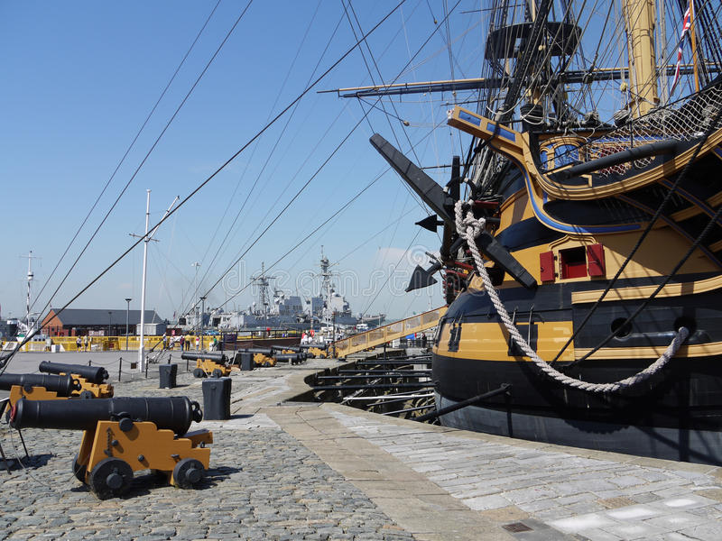 HMS Victory and modern frigates Portsmouth Harbour. royalty free stock photos