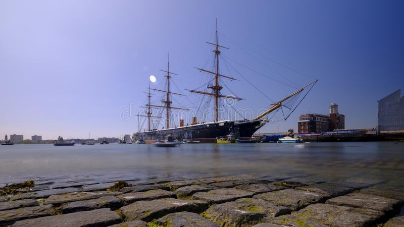 HMS Warrior (1862) - the first British ironclad battleship built for the Royal Navy -  in spring afternoon light with slow shutter. Speed, Portsmouth, Hampshire stock photography