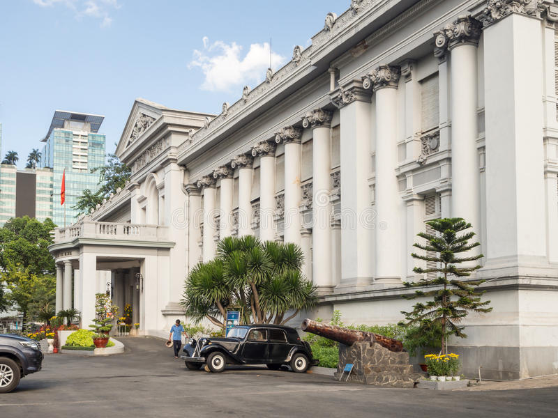 Ho Chi Minh City, Saigon, South Vietnam: [ Ho Chi Minh City Museum, French style, with old car and historic canon ] royalty free stock photos