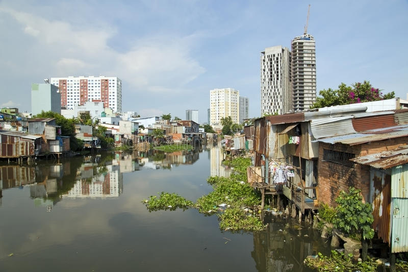 Ho Chi Minh City slums by river, Saigon, Vietnam stock photo