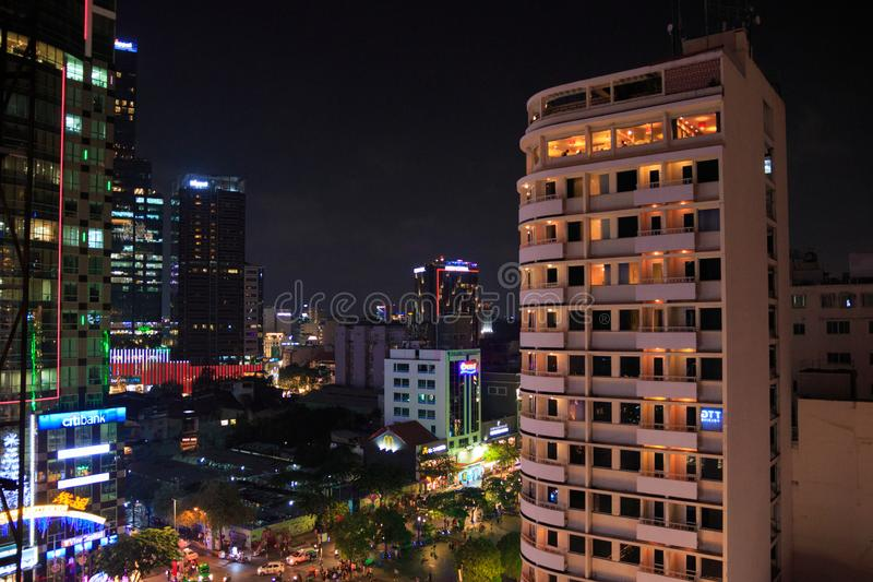 Ho Chi Minh city, Vietnam - December 2018: cityscape with walking street, high building, neon signboard and lights. stock photo