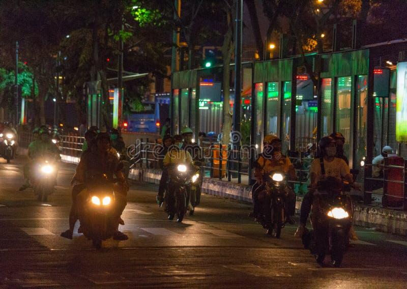 Night motorbike traffic Saigon Vietnam. Ho Chi Minh City, Vietnam - May 13, 2018: Motorbikes traffic at a intersection in central Saigon by night stock photo