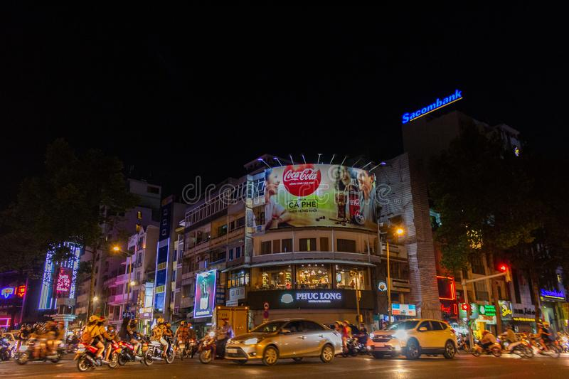 Night motorbike traffic Saigon Ho Chi Minh City Vietnam. Ho Chi Minh City, Vietnam - May 13, 2018: Motorbikes traffic at a intersection in central Saigon by royalty free stock photography