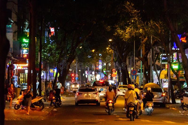 Saigon night traffic Vietnam. Ho Chi Minh City, Vietnam - May 13, 2018: Motorbikes traffic in a small street in central Saigon by night stock photography