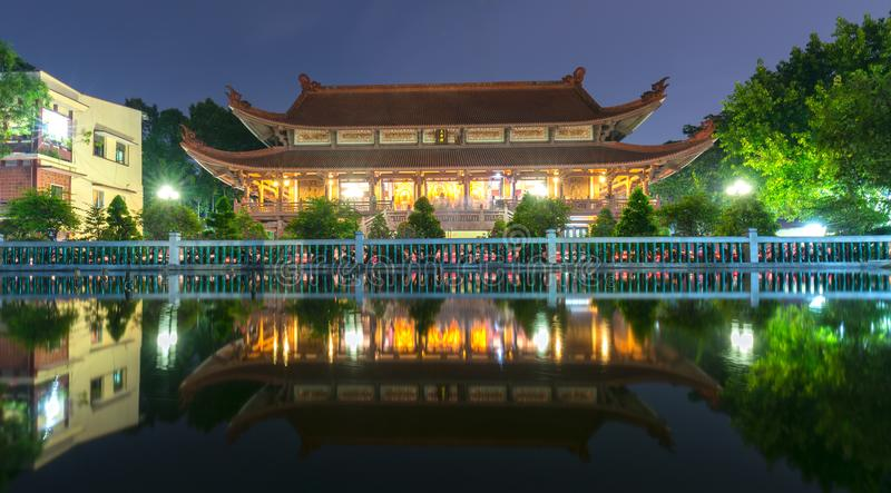 Architecture temple at night when lights flickered as glorified spiritual beauty. stock photos