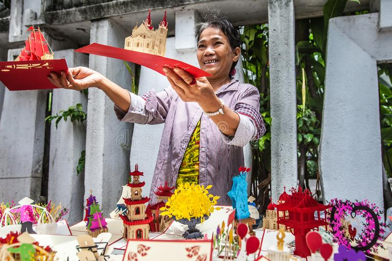 Woman, 3d postcards street vendor. Ho Chi Minh, Vietnam. royalty free stock photos