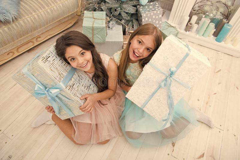 Ho Ho Ho. Cute little children girls with xmas present. happy little sisters celebrate winter holiday. christmas time. Family. happy new year. delivery royalty free stock photo