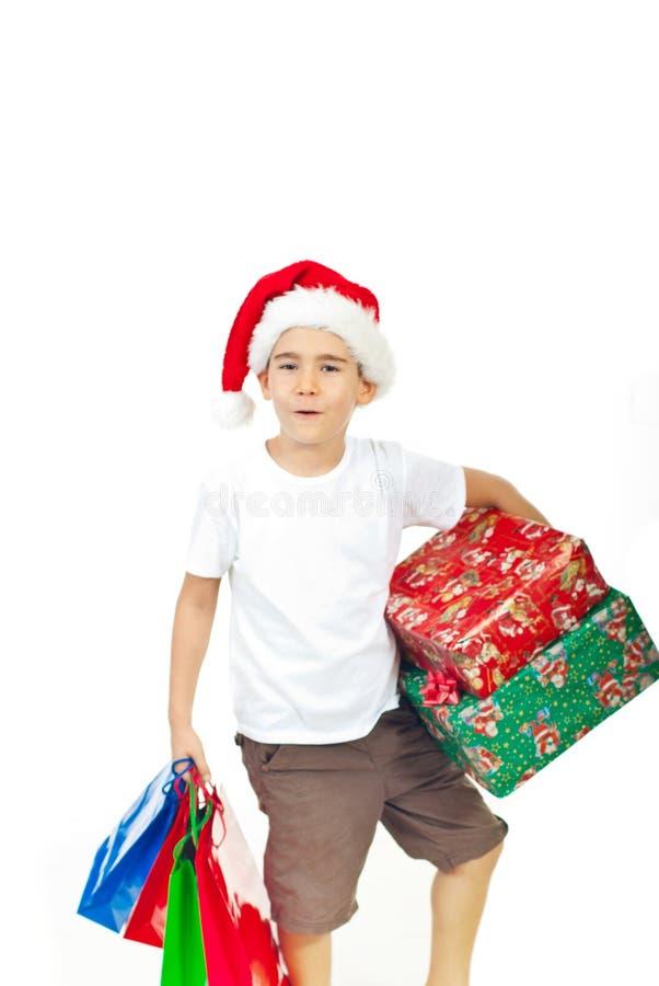 Ho-ho-ho ! Garçon avec des présents de Noël photo libre de droits