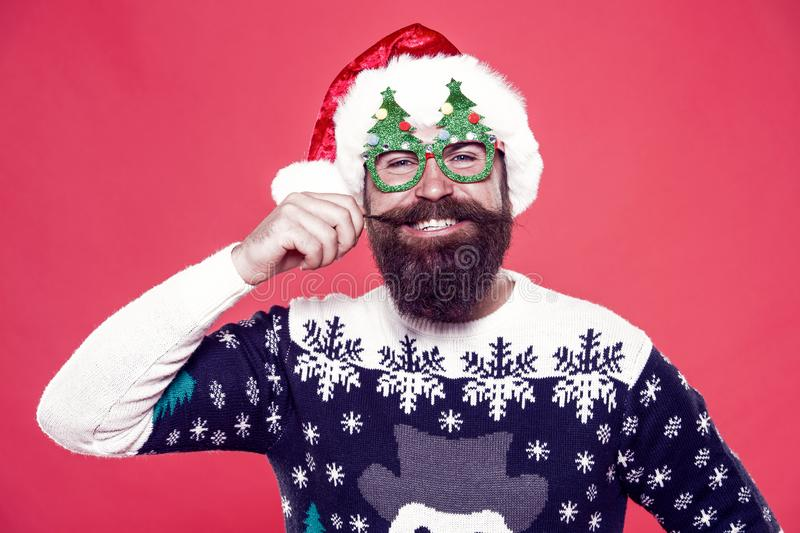 Ho-ho-ho. Happy santa twirl long mustache hair. Bearded man smile with stylish mustache. Beard and mustache winter royalty free stock photos