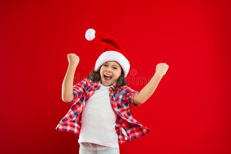 Ho Ho Ho. Happy winter holidays. Small girl. New year party. Santa claus kid. Christmas shopping. Present for Xmas stock photography