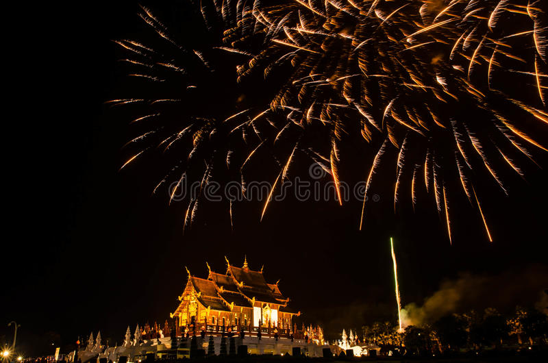 Ho kham luang northern thai style building in Royal Flora temple ratchaphreukin Chiang Mai,Thailand.Firework.  stock photo