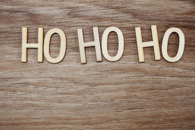 Ho ho ho Santa exclamation lettering on wooden background Christmas concept royalty free stock photography