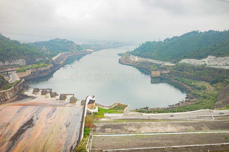 Hoa Binh, Vietnam - Jan 14, 2016: Hoa Binh Hydroelectricity Plant area on misty day. The plant was built from 1979 to 1994 with 8. Machines provides 1920 MW stock image